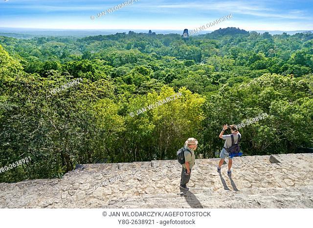 Tourists on the top of Temple IV, Ancient Maya Ruins, Tikal National Park, Yucatan, Guatemala