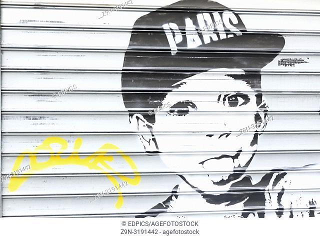 "black and white stencil portrait of a boy wearing a baseball cap with the writing """"paris"""", paris, ile de france, france"