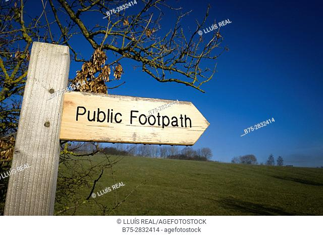 Public Footpaht Wooden signpost  with blue sky. Skipton, North Yorkshire, England, UK