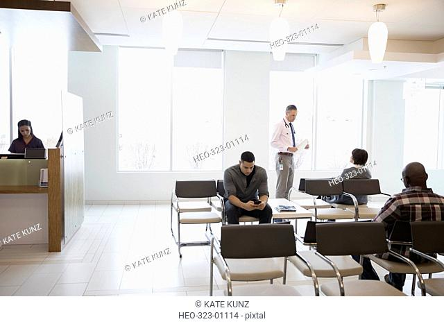 Doctor and patients in clinic waiting room