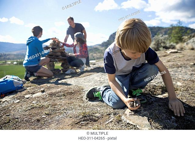 Family gathering and stacking rocks