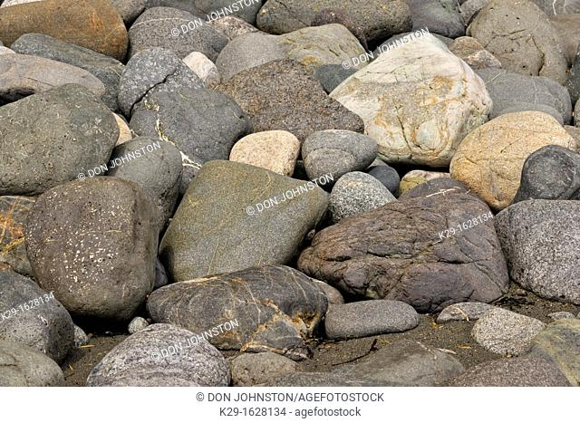 Coastal rocks sculpted by tidal action on the shore of Juan de Fuca Strait SOOKE, BC