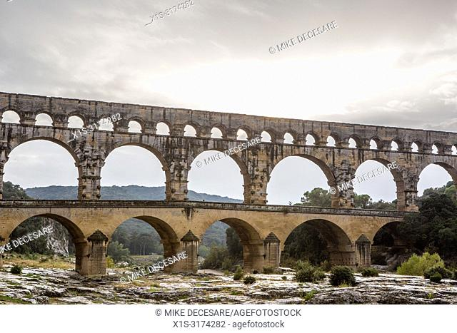 Pont Du Gard, an aqueduct in the south of France, was build by the Romans to distribute water to communities throughout their empire and a newer