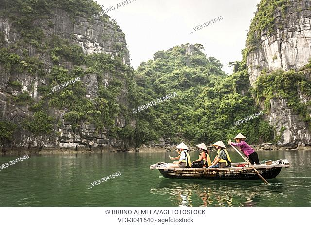 A tourists boat in the karst landscape of Ha Long Bay, Quang Ninh Province, Vietnam. Ha Long Bay is a UNESCO World Heritage Site