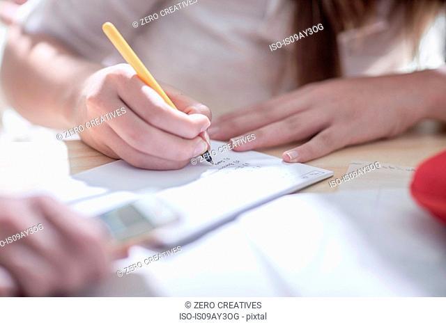 Close up of female designers hands making notes in design studio