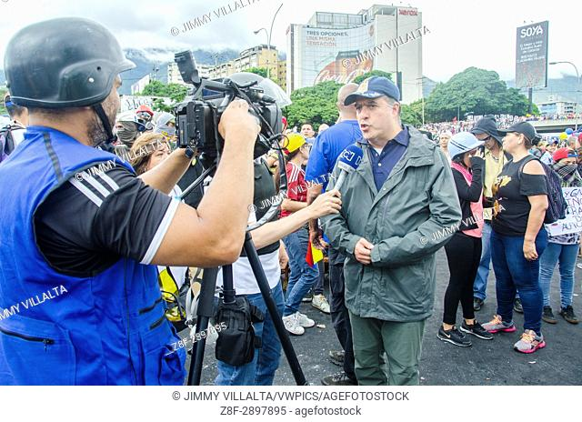 President of the National Assembly, Julio Borges speaks to the press in protest against the military base. Opposition protesters assembled on the Francisco...