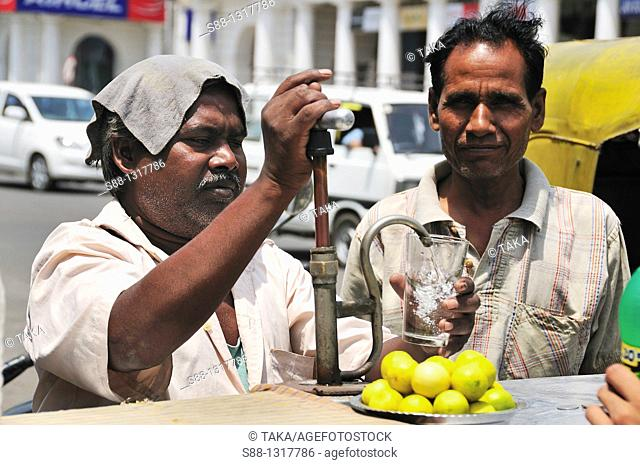 On the hot day the man selling cold lemon water in Connaught Place, Delhi India