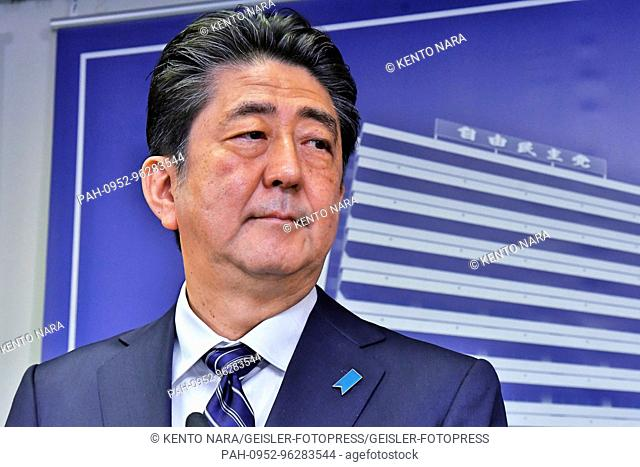 Japan's Prime Minister and ruling Liberal Democratic Party (LDP) president Shinzo Abe speaks during the press conference at his LDP headquarters in Tokyo