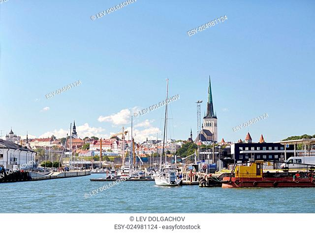 travel and tourism concept - view of sea port harbor and old town in tallinn city