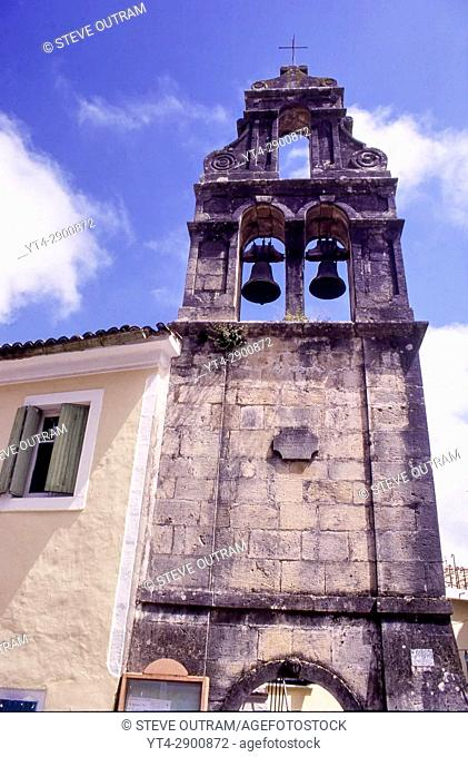 Medieval Bell Tower of unpainted stone in Sinarades Village, Corfu, Greece