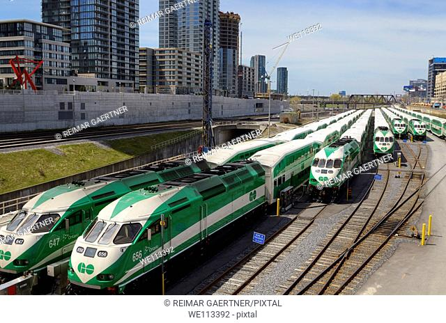 GO Train commuter railroad cars lined up on downtown Toronto tracks waiting for rush hour