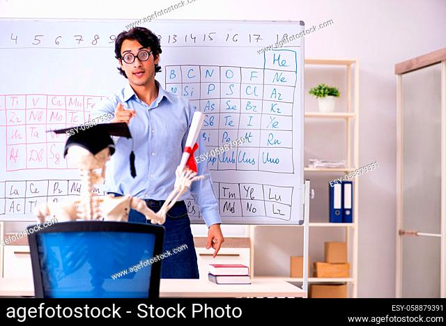 Young male chemist teacher and student skeleton