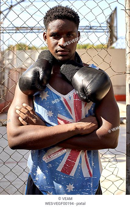 Portrait of confident boxer with his boxing gloves