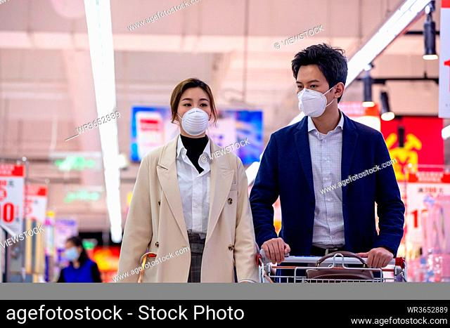 Young couple of shopping in the supermarket