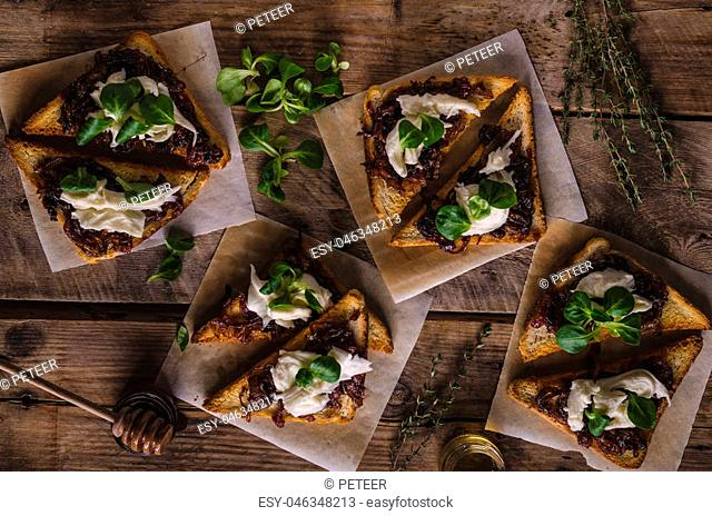 Rustic toast with caramelized onion, goat cheese, garlic and herbs