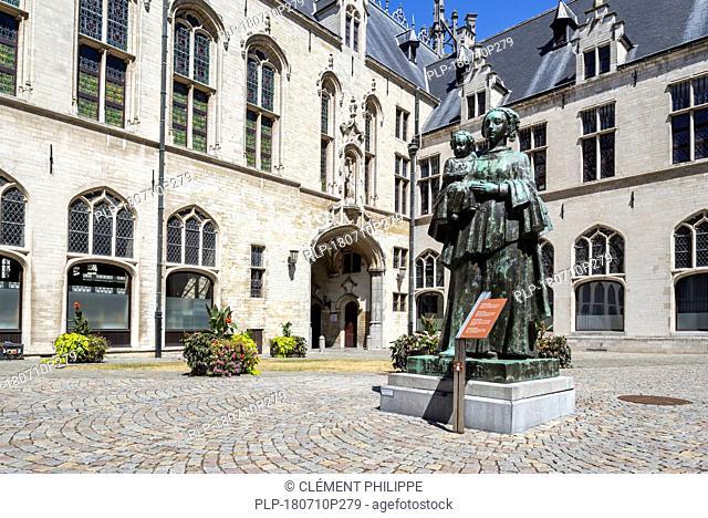 Statue De Moeder / The Mother by sculptor Ernest Wynants in the courtyard of the Mechelen / Malines city hall, Flanders, Belgium