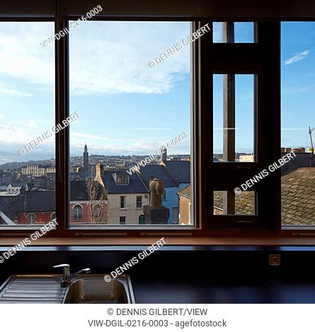 Window view towards city with catholic and protestant churches. St Angela's College Cork, Cork, Ireland. Architect: O'Donnell Tuomey Architects, 2016