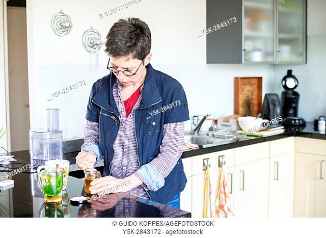 Tilburg, Netherlands. Mid adult caucasian woman, having multiple sclerosis or MS for over a decade, succesfully halting the disease by eating and drinking very...