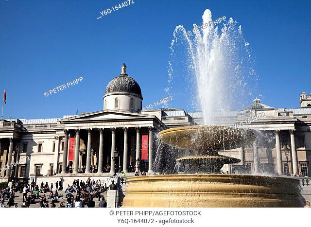 Trafalgar Square fountains and the National Gallery in London