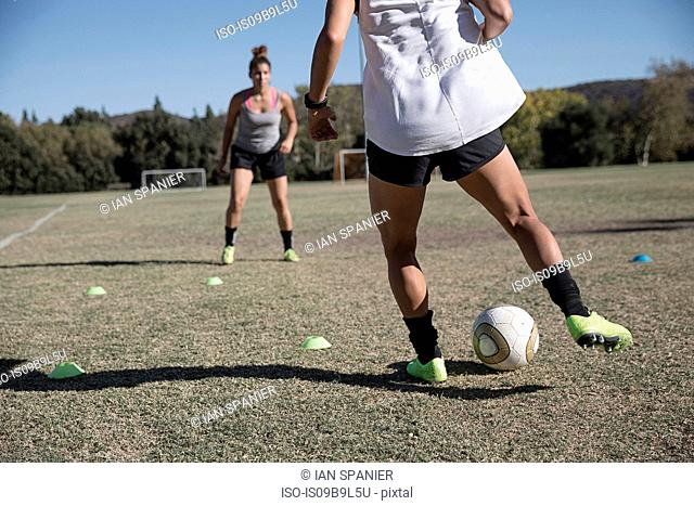 Women on football pitch playing football