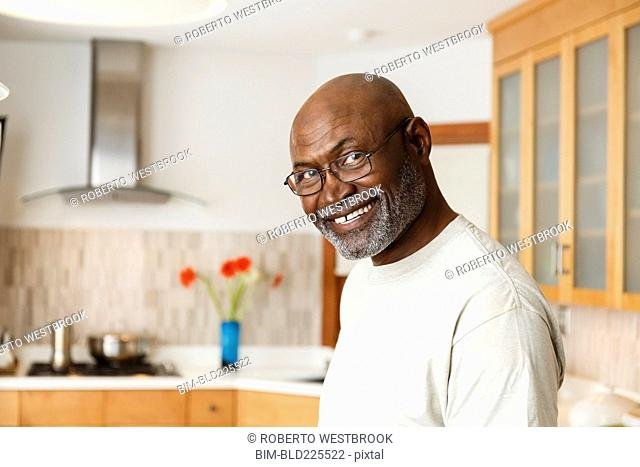 Black man smiling in kitchen