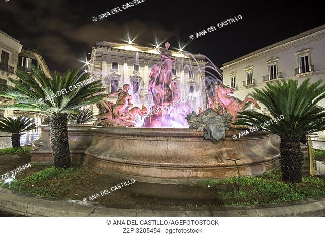 Illuminated Diana fountain Night in Ortigia island Siracusa Syracuse Sicily island Italy