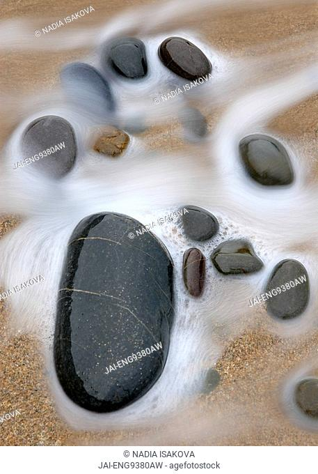 Wave and pebbles, Sandymouth Beach, Cornwall, UK