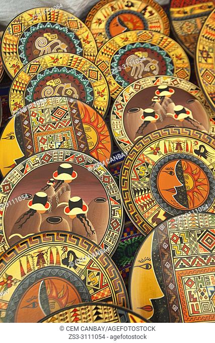 Close-up shot of ceramic plates at the open-air art and craft market in Pisac, Sacred Valley, Cusco Region, Peru, South America