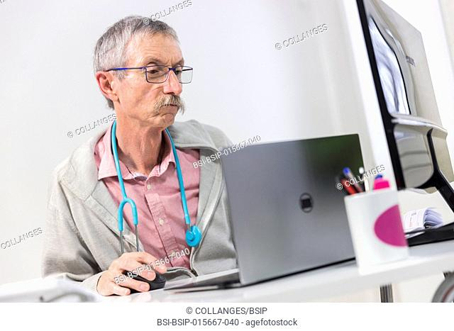 Doctor in front of laptop