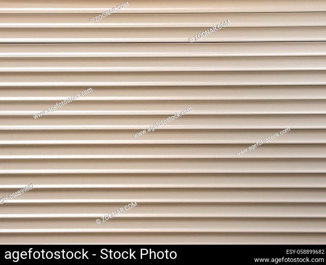 white metal roller shutter from shop door