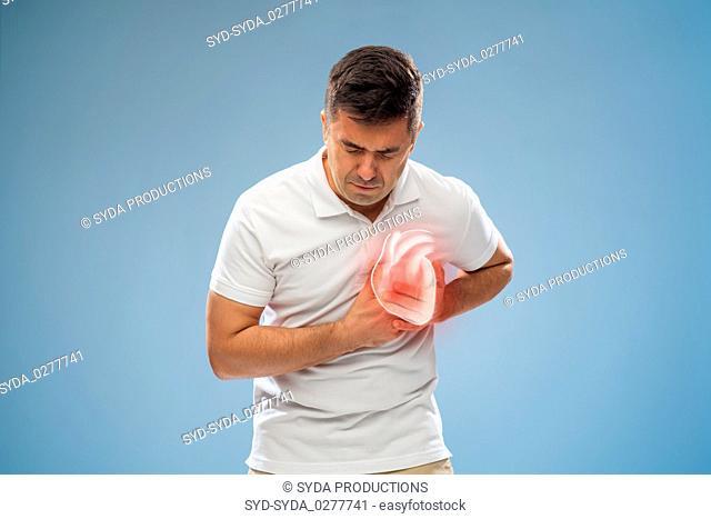 unhappy man having heart attack or heartache