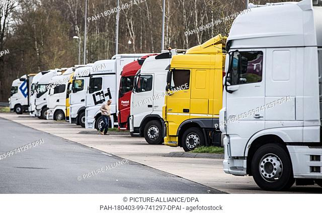 03 April 2018, Germany, Rodgau-Weiskirchen: Trucks are parked in the service station Weiskirchen next to the A3 highway. Goal of the German Trade Union...