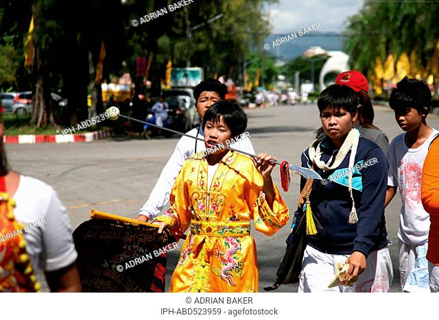 Thailand Phuket Festivals Mah Jong, with their faces pierced walk in procession through the streets of Phuket