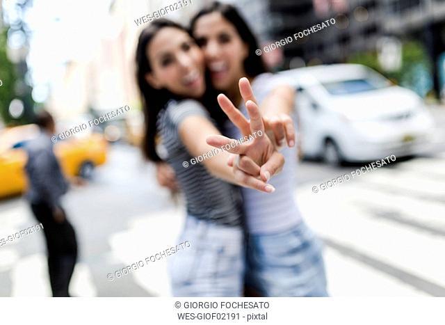 USA, New York City, two young women in Manhattan having fun