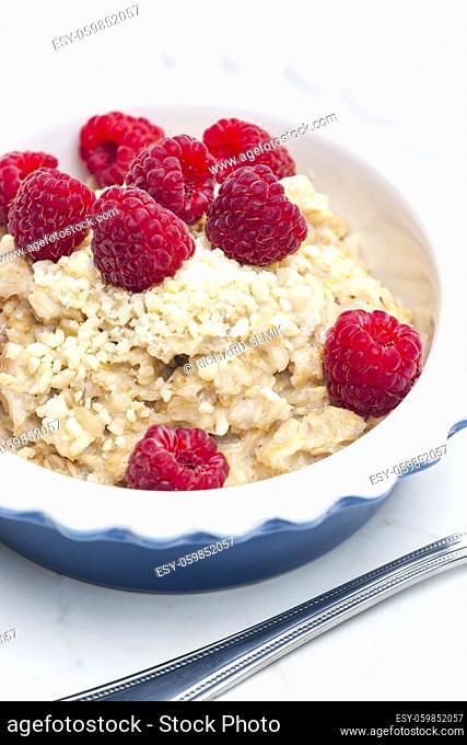 still life of porridge with raspberries