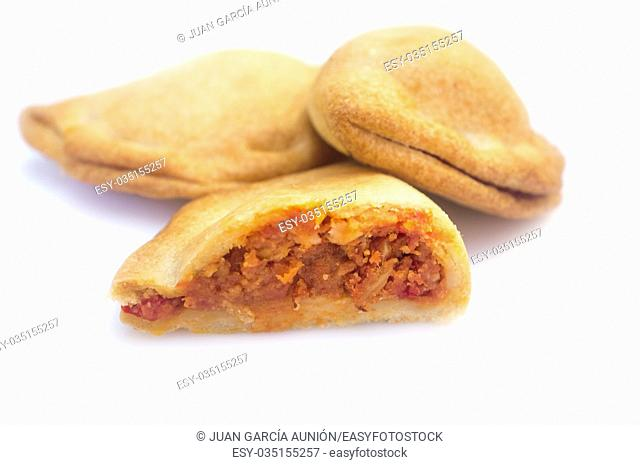 Typical spanish empanadillas or tuna small turnover. Isolated over white background