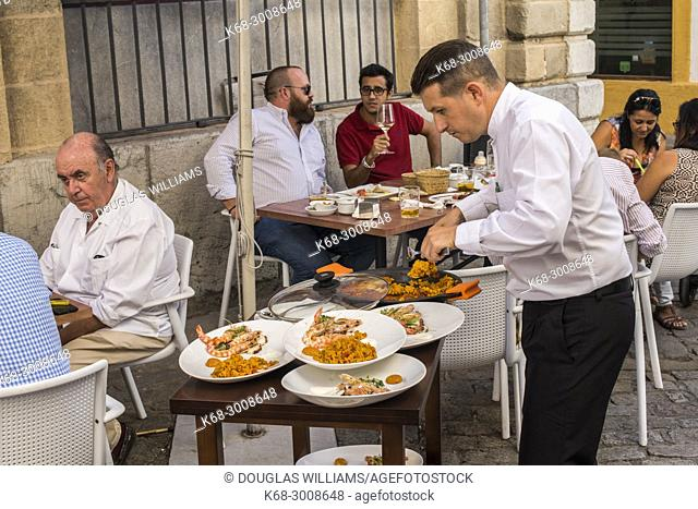 People enjoying outdoor dining in the street in Jerez de la Frontera, Cadiz province, Andalucia, Spain