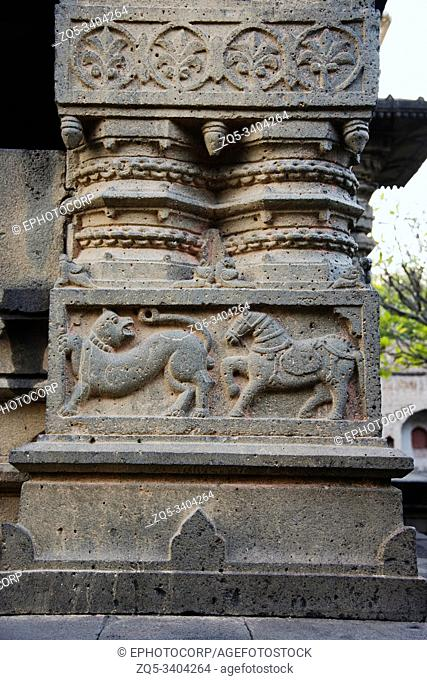 Tiger and Horse figures carved on huge stone pillar, Sangmeshwar Temple in Saswad, Pune District, Maharashtra, India