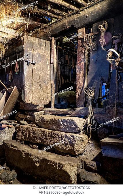 "Entrance door to the stable or """"cut of cows"""". Interior of the Palloza-museum """"Casa do Sesto"""". Piornedo de Ancares. The Ancares. Lugo. Galicia"