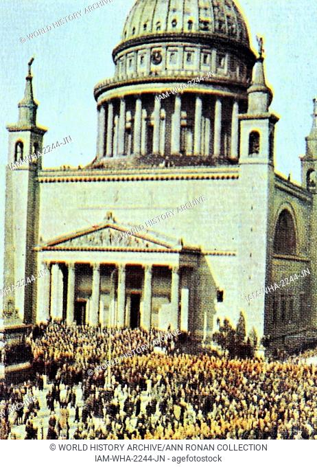 The nikolai Church in Berlin with Nazi marchers in front. Circa 1933