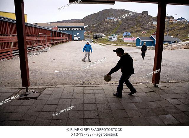School boys playing soccer  Qaqortoq Julianehåb, South Greenland