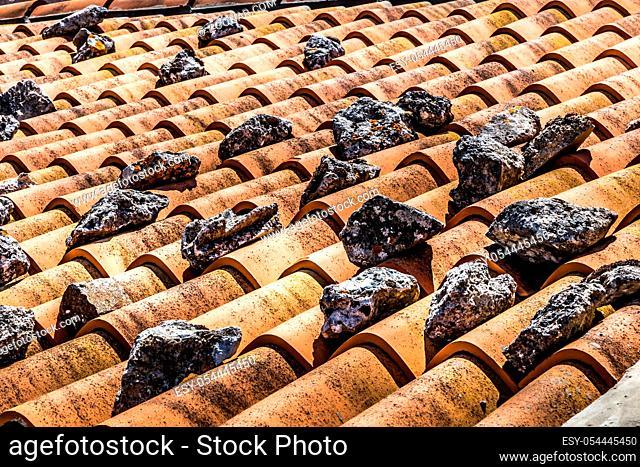 detail roof tiles with stones, Province of Foggia, Apulia (Puglia), Italy