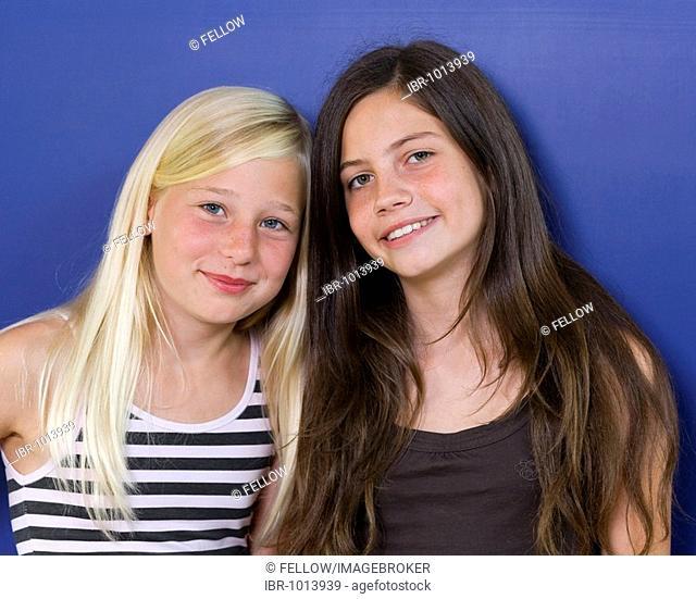 Two girls, eleven years, girlfriends, portrait