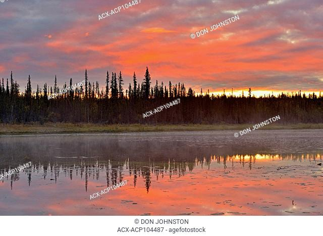 Dan skies over a beaver pond, Yellowknife, Northwest Territories, Canada