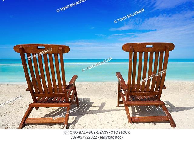 Caribbean sea pair of hammocks on the beach of Mexico
