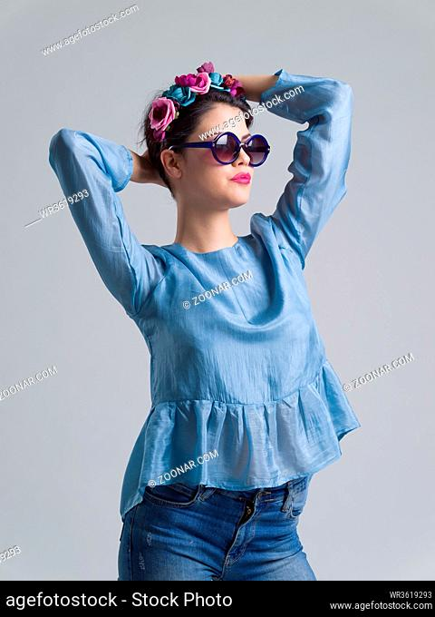 Fashion Model girl isolated over white background. Beauty stylish woman posing in fashionable clothes and sunglasses. Casual style with beauty accessories