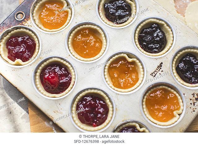 Jam tarts in a muffin tin