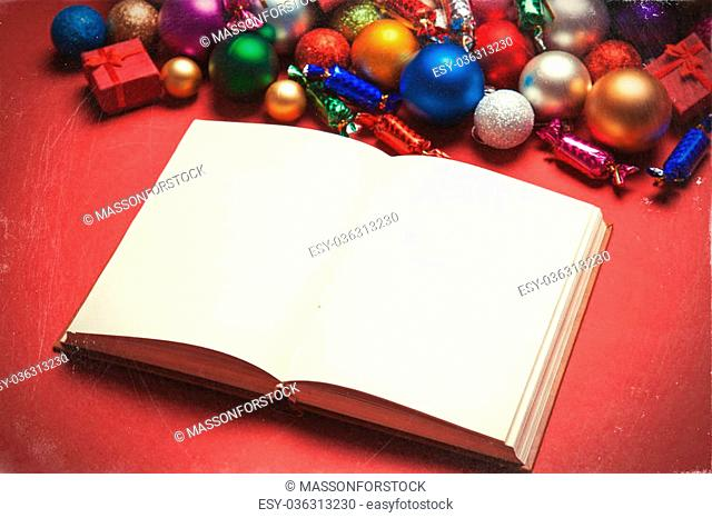Book and chritmas toys on white background