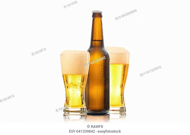 A bottle and two glasses of beer isolated on white background