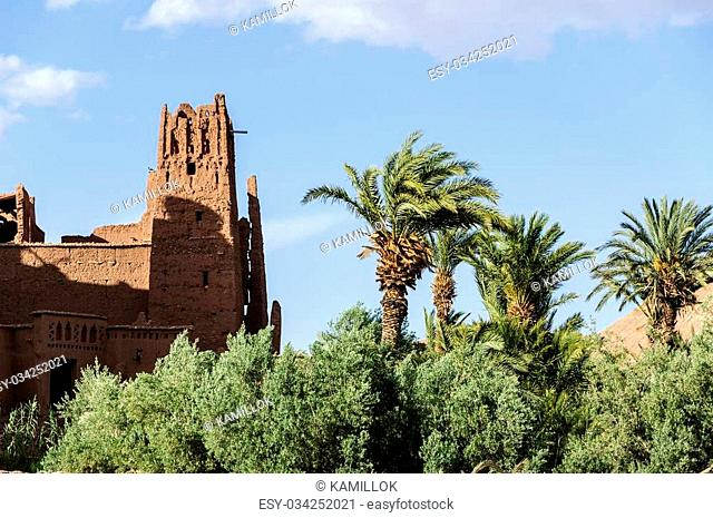 Morocco, Kasbah of Ait Ben Haddou with palms